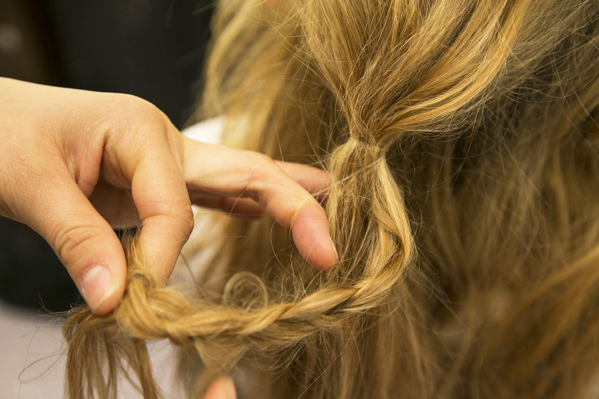 To hide the elastic, take a small section of hair from the ponytail and create a loose braid.