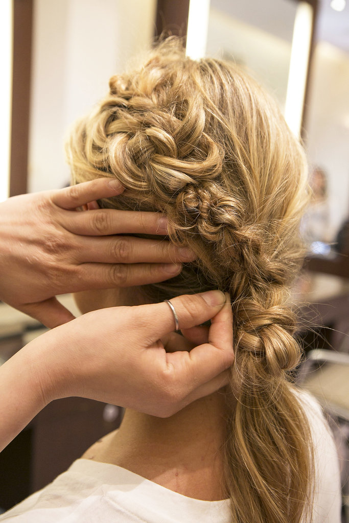 Bring the knotted hair up and connect it with the braid on the left side and pin it in place.