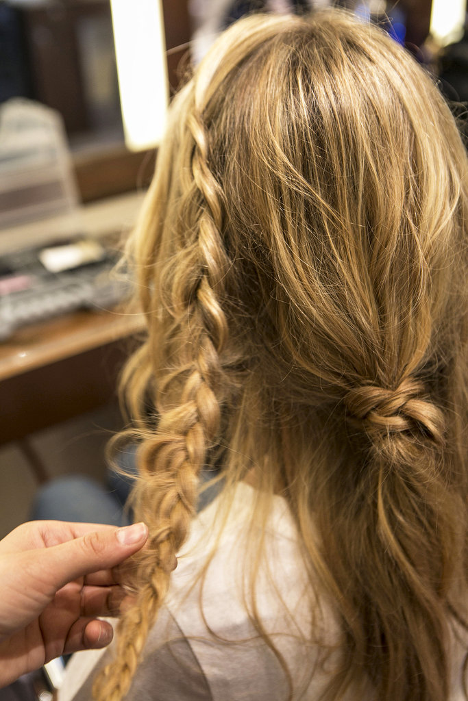 Continue to braid all the way down, and pull at the braid to give it extra texture and width before securing with an elastic.