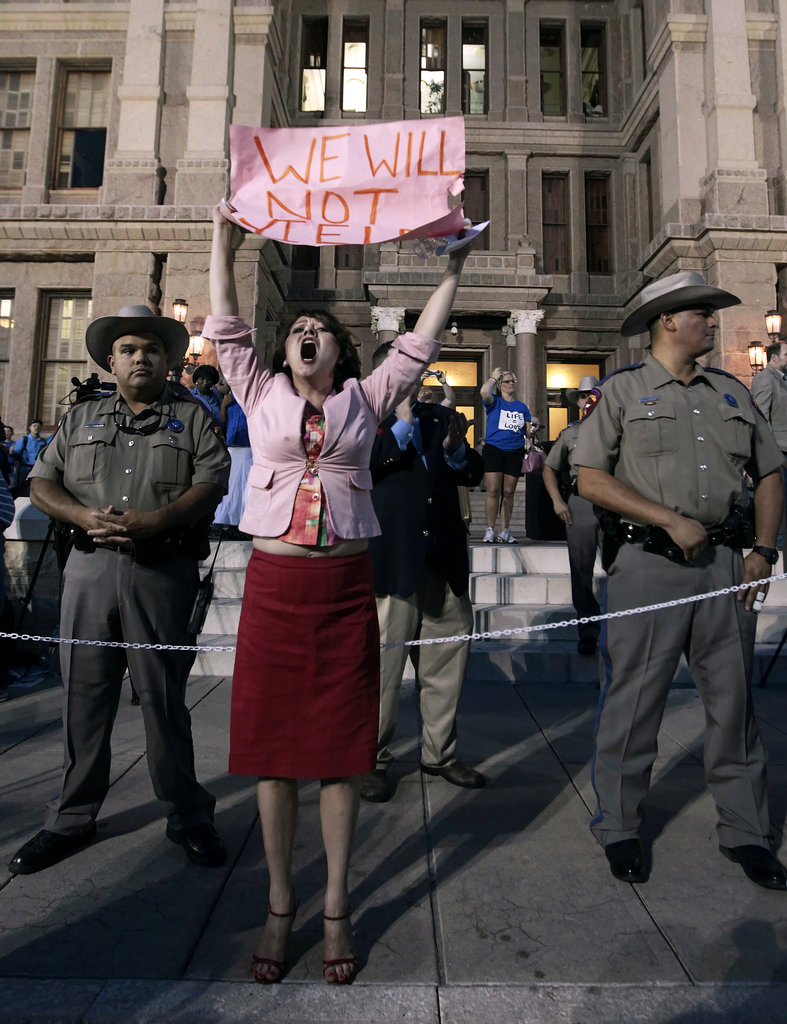 """One pro-choice woman held up a sign that read, """"We will not yield."""""""