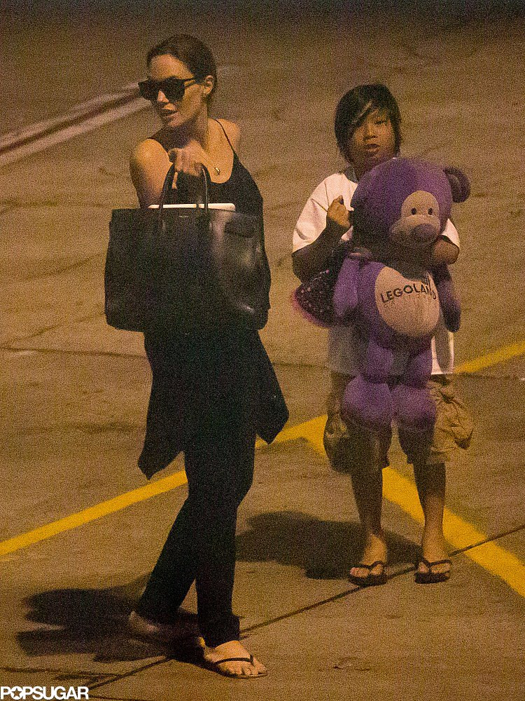 Angelina Jolie had Pax as her travel companion as they arrived back in LA after a trip to Hawaii.