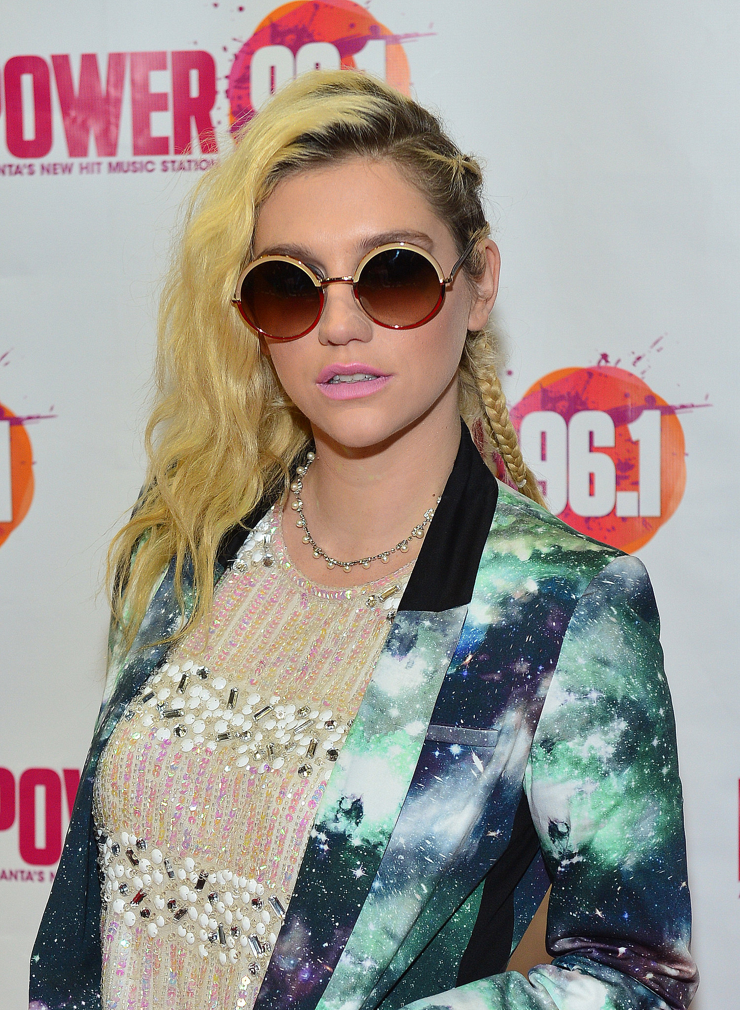 Known for her unique style, Ke$ha wore a braided undercut that showed off her dark roots and rock-star style.