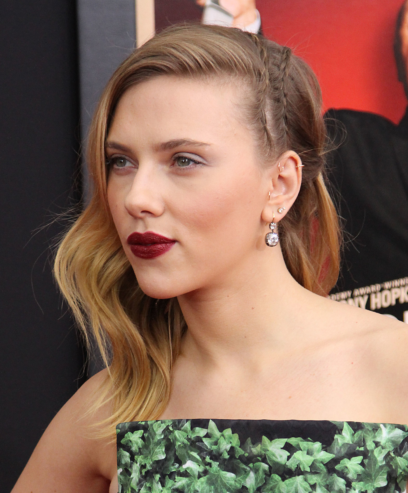 Vampy lipstick and a couple diagonal cornrows took Scarlett Johansson's waved style from typical to noteworthy.