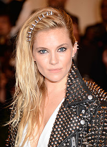 Sienna-Miller-pulled-her-tousled-hair-over-right-secured