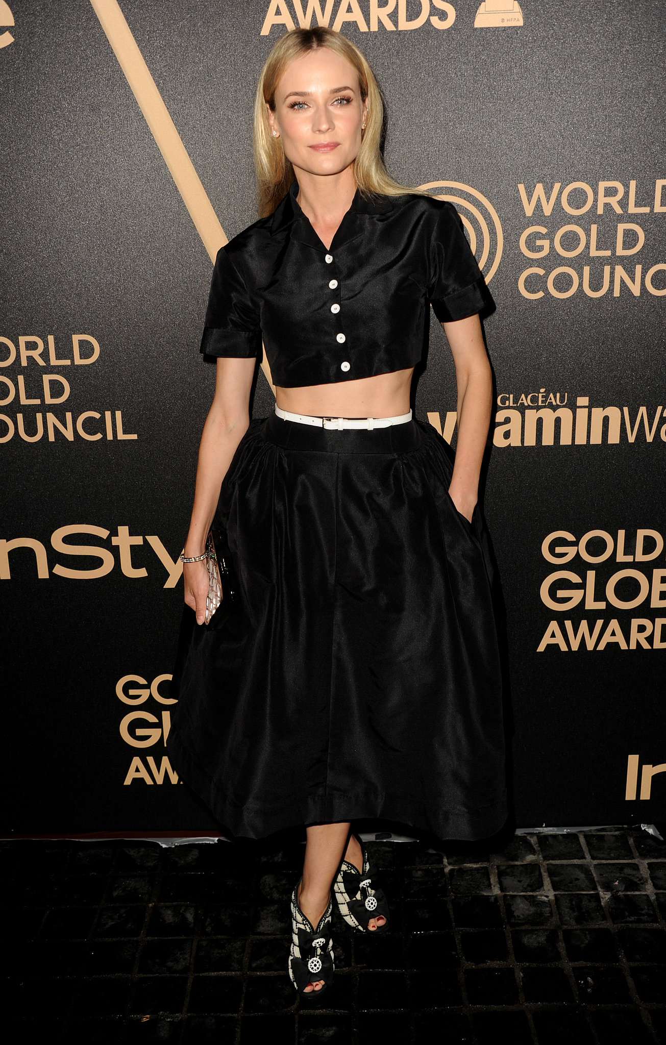 Diane owned the crop-top trend in a Rochas top and full skirt, cinched with a crisp while belt, paired with black and white Chanel booties during an award season celebration in November 2012.