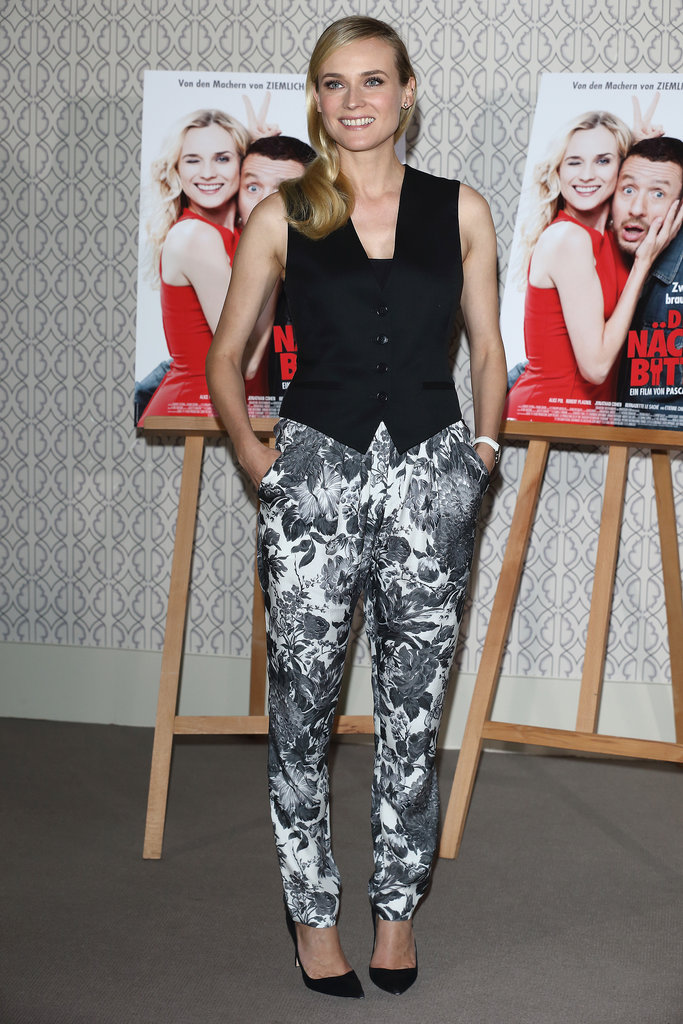 Diane showed off her style prowess in a borrowed-from-the-boys look while promoting her new movie Der Naechste, Bitte! in Berlin. Kruger tempered her silk floral-print pants with a fitted tuxedo vest, both by Stella McCartney, and a cool-girl white watch.