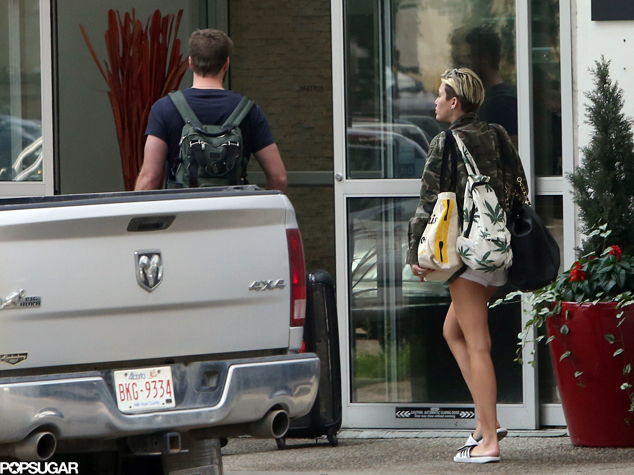 Miley Cyrus and Liam Hemsworth headed into a hotel in Alberta, Canada.