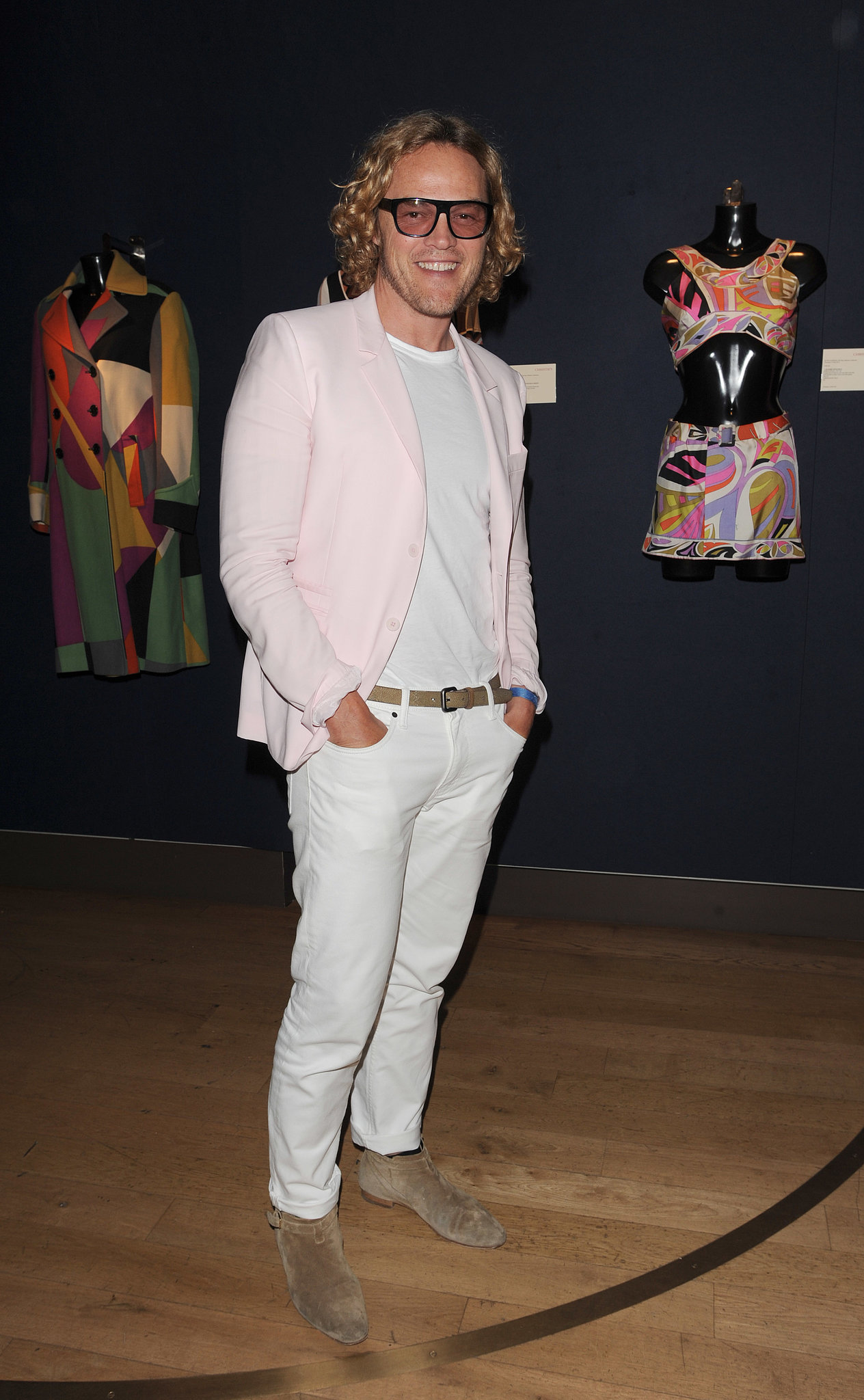 Peter Dundas attended the private viewing of In My Fashion: The Suzy Menkes Collection in summery separates.