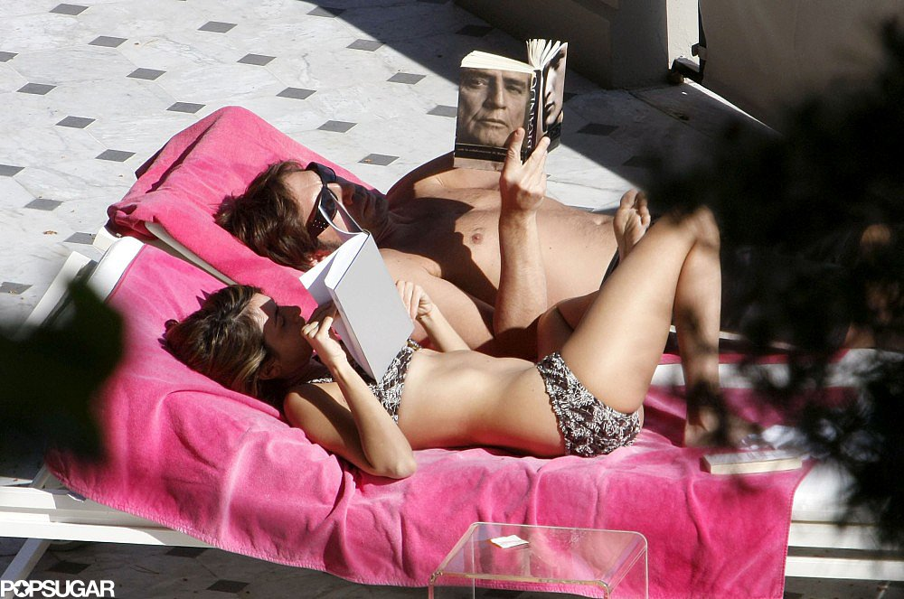 The couple got a bit of sun while reading together during a vacation in Nice in March 2008.