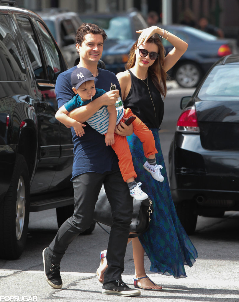 Orlando Bloom carried Flynn during a day out with Miranda Kerr.