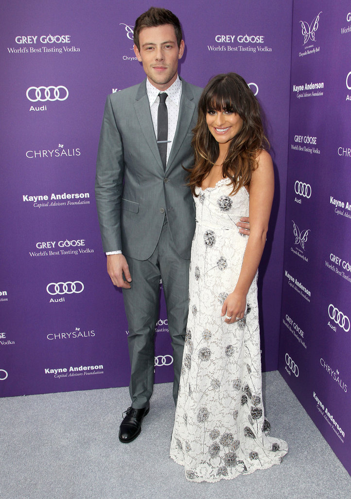 Lea Michele and Cory Monteith hugged on the gray carpet at an event in LA in June 2013.