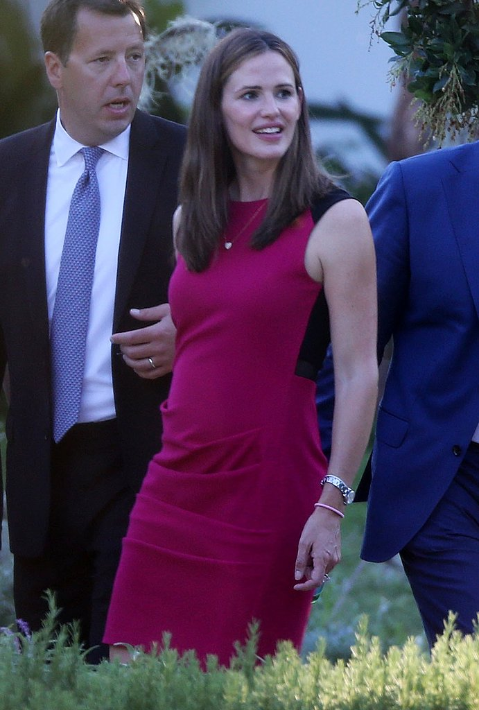 Jennifer Garner, also a guest at Kimmel's nuptials, opted for a berry-hued sheath dress featuring a black panel in the back.