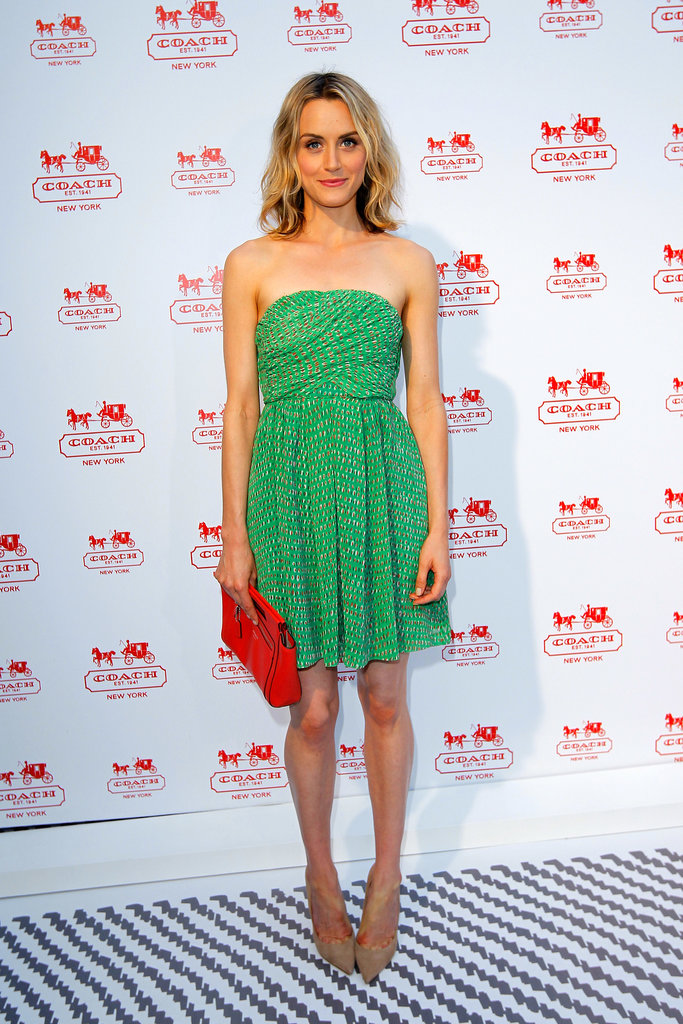 For a Coach benefit in LA, the actress slipped into a bright, strapless dress and finished with a candy-apple-red Coach (of course!) clutch.