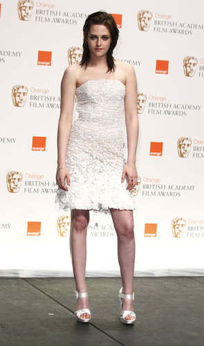 Paging all Winter wonderland princesses: Stewart looked breathtaking in a white paillette-trim Chanel dress and equally charming satin sandals while out in London in 2010.