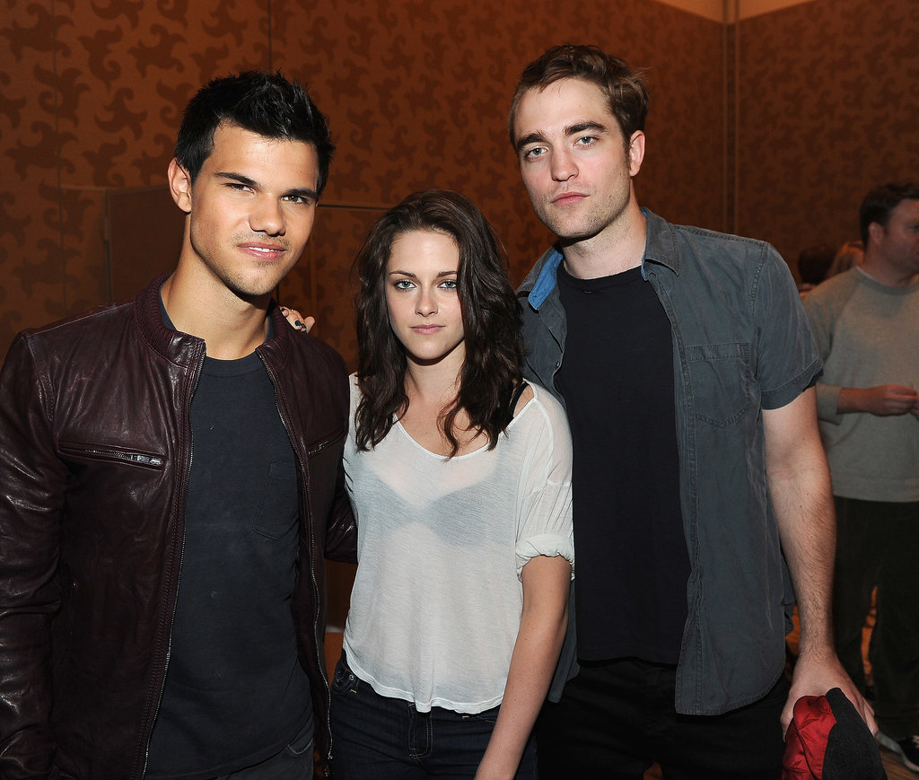 Robert Pattinson, Kristen Stewart, and Taylor Lautner posed together during the Breaking Dawn: Part 1 press conference in 2011.