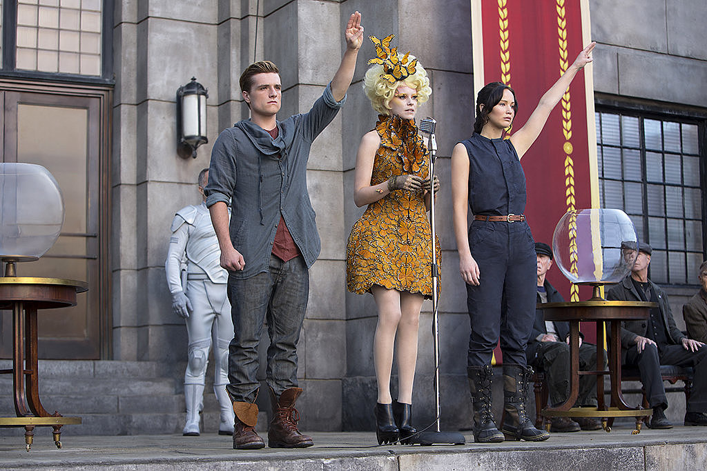 Josh Hutcherson as Peeta, Elizabeth Banks as Effie, and Jennifer Lawrence as Katniss in Catching Fire.