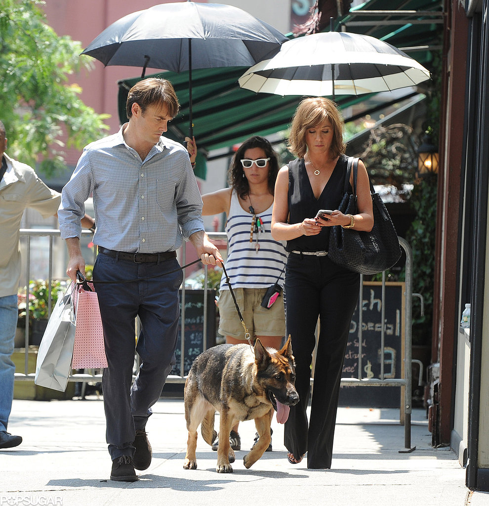 Jennifer Aniston and Will Forte were followed by personal umbrella holders on the NYC set of Squirrels to the Nuts on July 17.