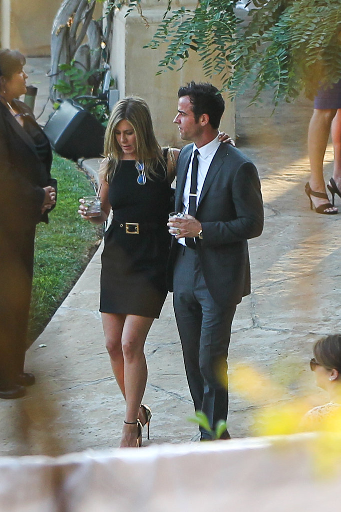 Jennifer Aniston and Justin Theroux looked loved-up and relaxed as they strolled the Californian grounds where Jimmy Kimmel was married over the weekend.