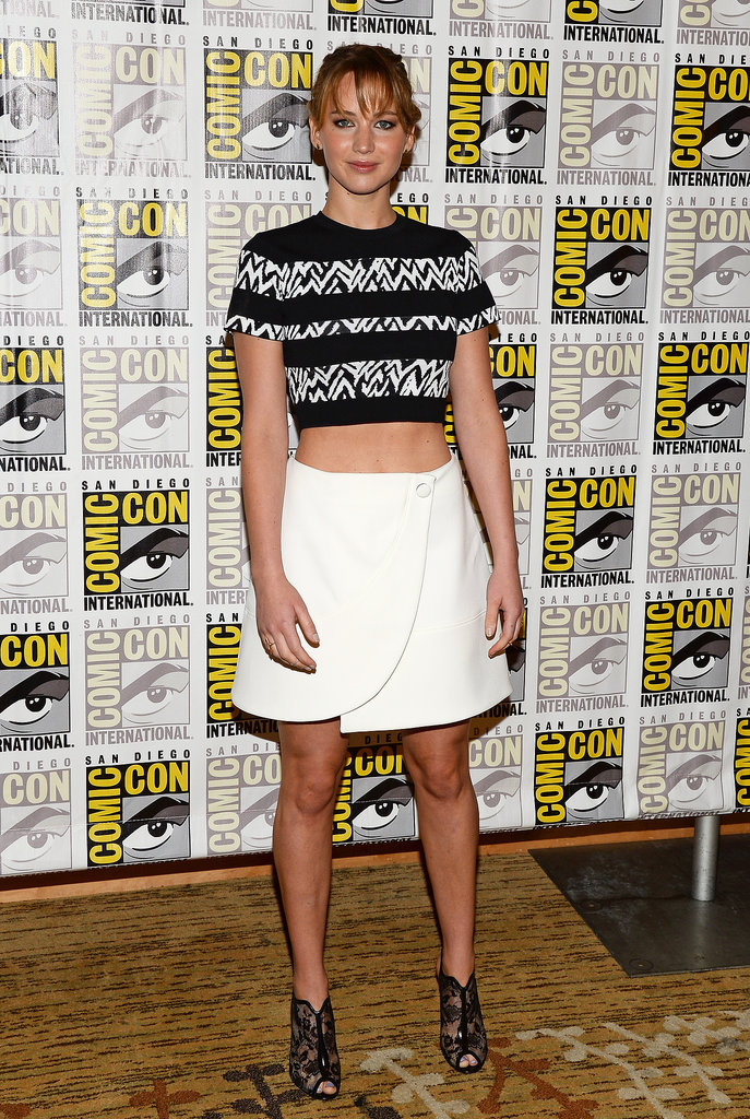 Jennifer Lawrence paired a Proenza Schouler crop top with a white skirt and finished the look with Nicholas Kirkwood heels at a panel for her movie The Hunger Games: Catching Fire.