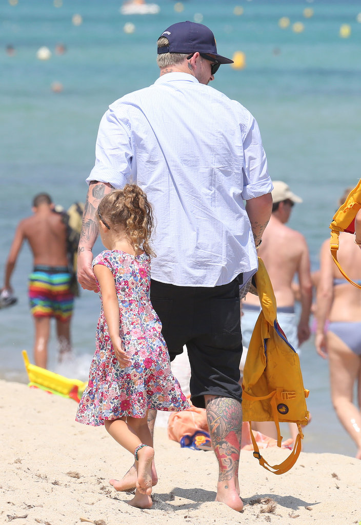 Joel Madden held on to his daughter's hand.