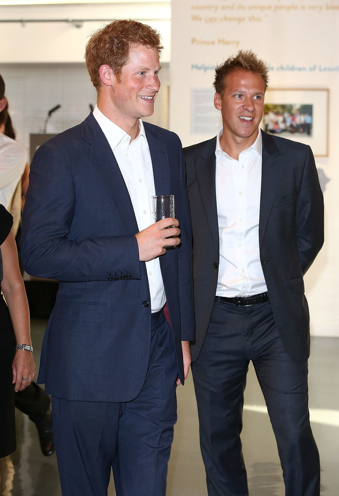 New uncle Prince Harry couldn't keep the smile off his face when he attended a private viewing of royal photographer Chris Jackson's gallery in London on July 25.