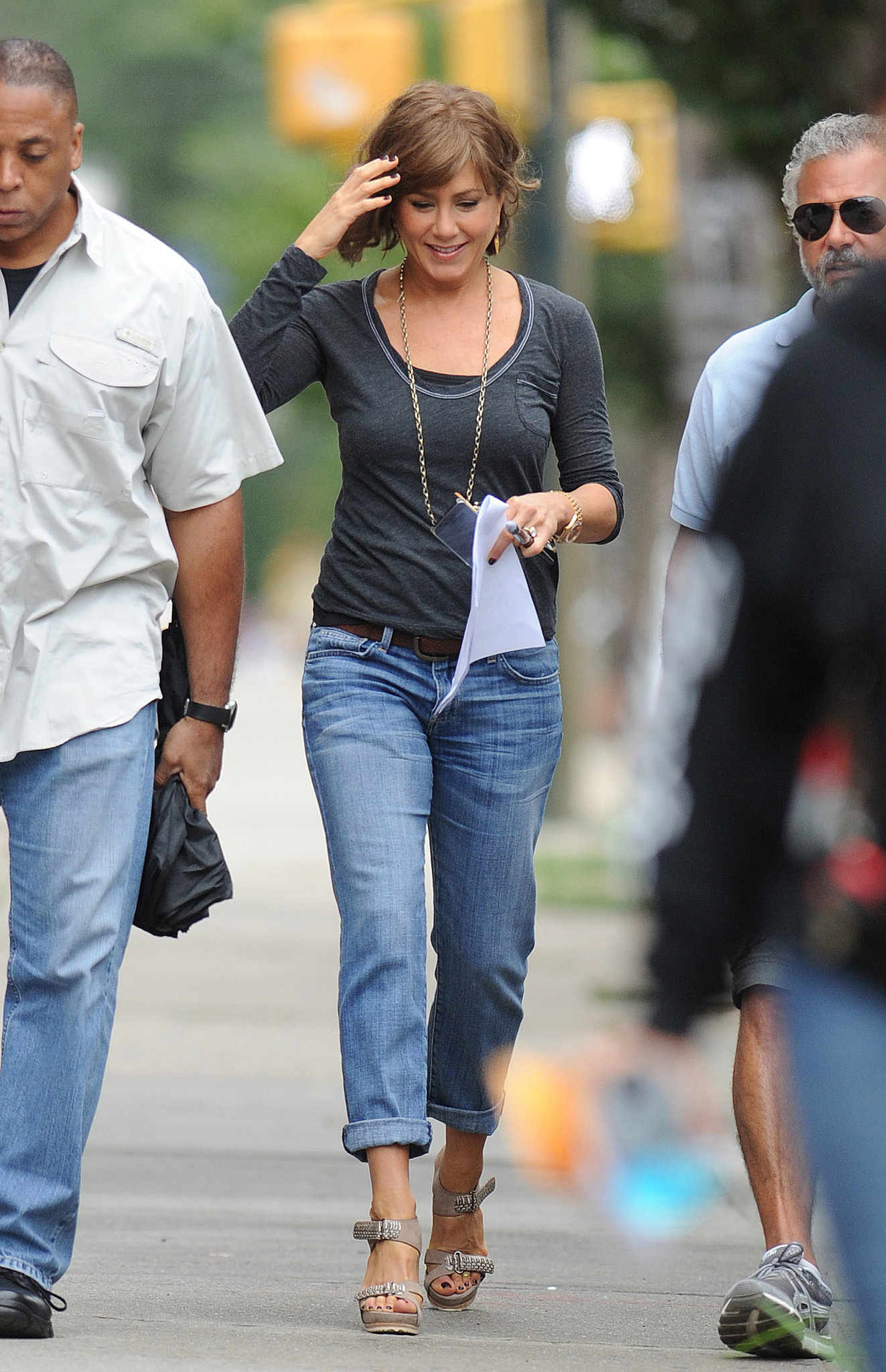 Jennifer Aniston also wore jeans and heels while walking around the set on July 25.