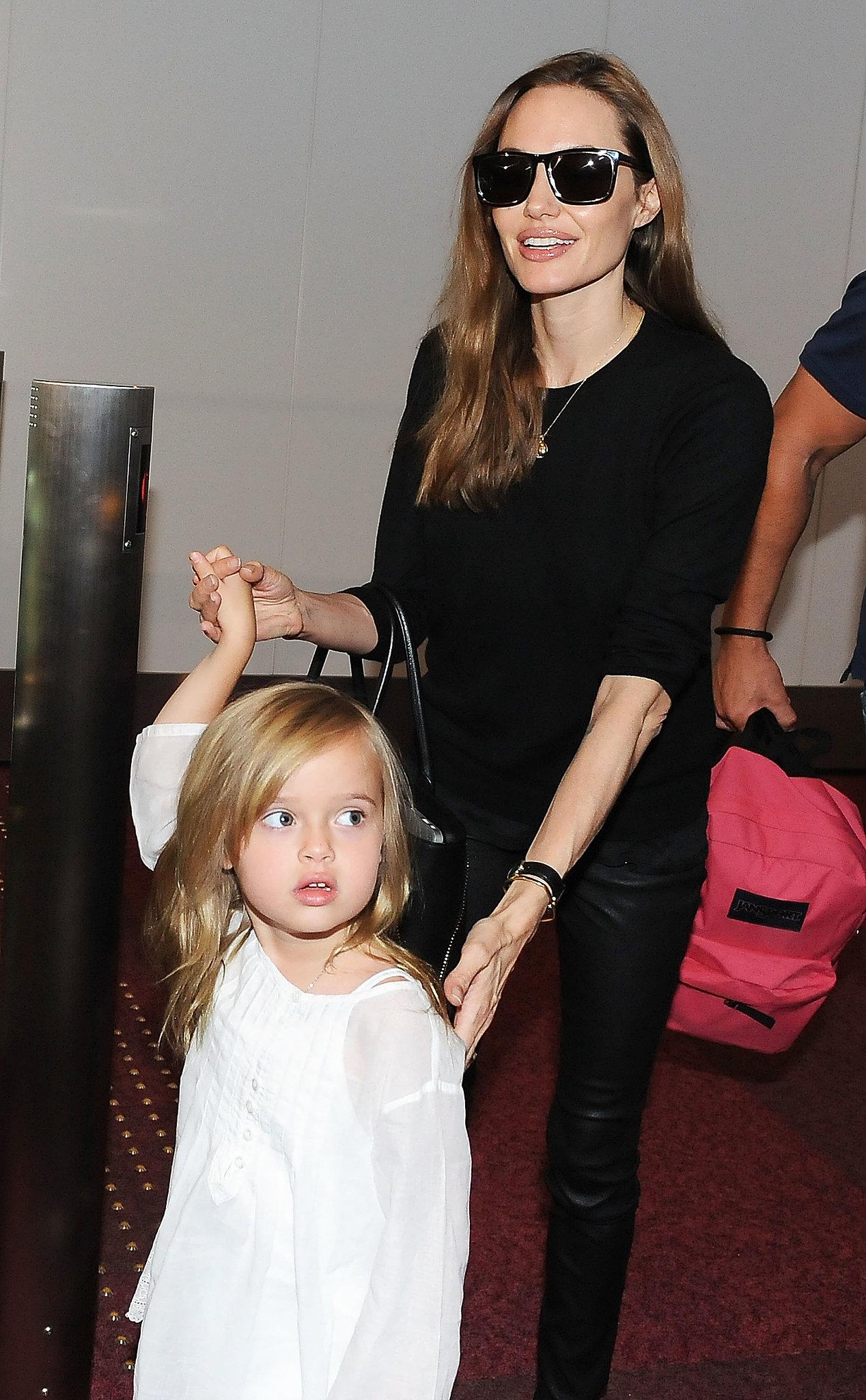 Angelina Jolie held hands with Vivienne.