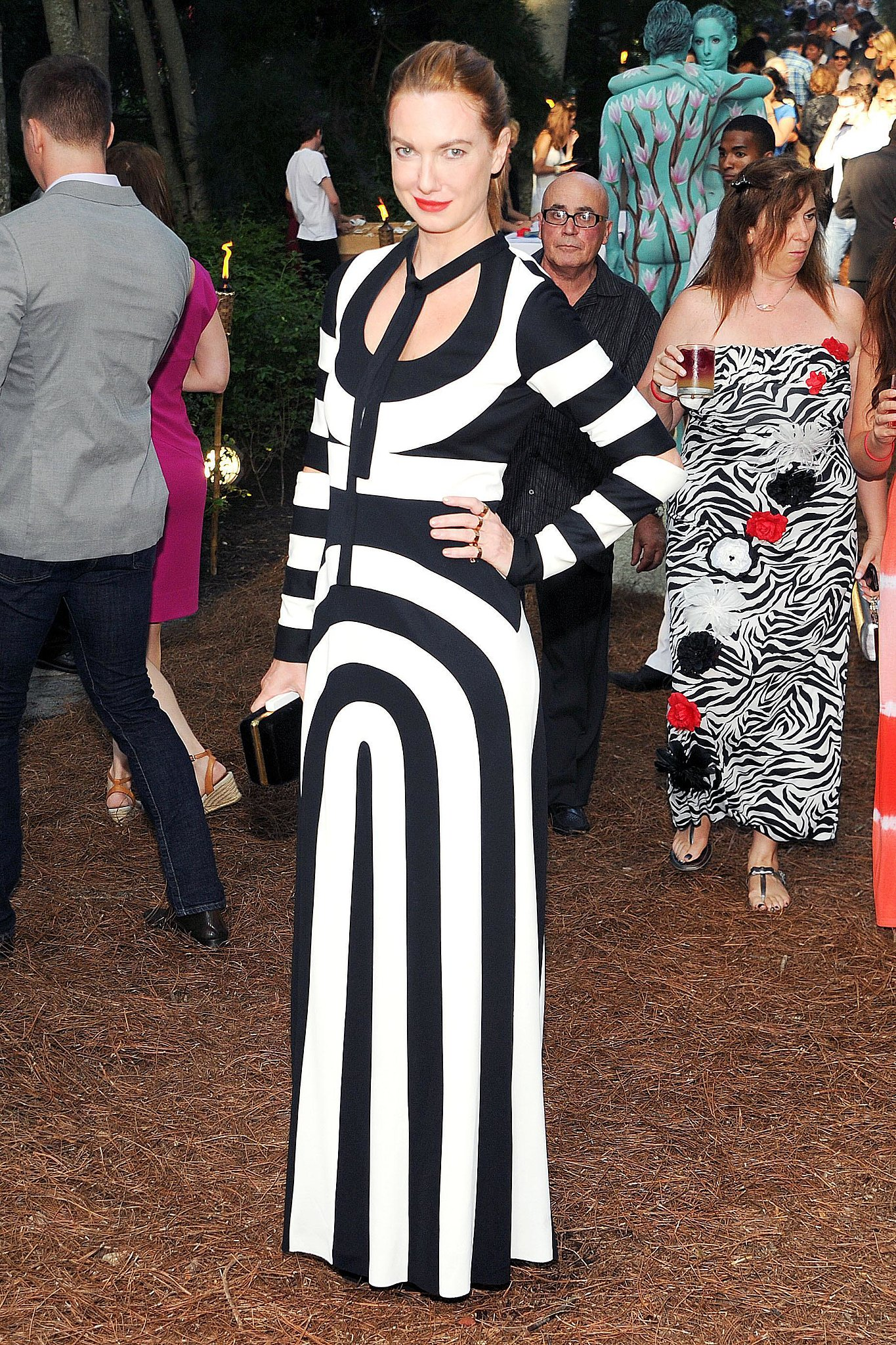 Polina Proshkina was not to be missed in her graphic Marc Jacobs gown while attending the annual Watermill Center benefit.