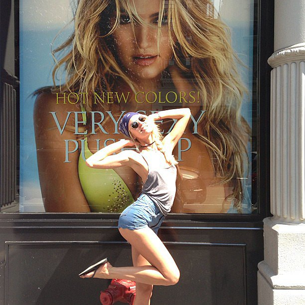 Candice Swanepoel stopped on the street to pose in front of a window display of herself at Victoria's Secret. Source: Instagram user angelcandices