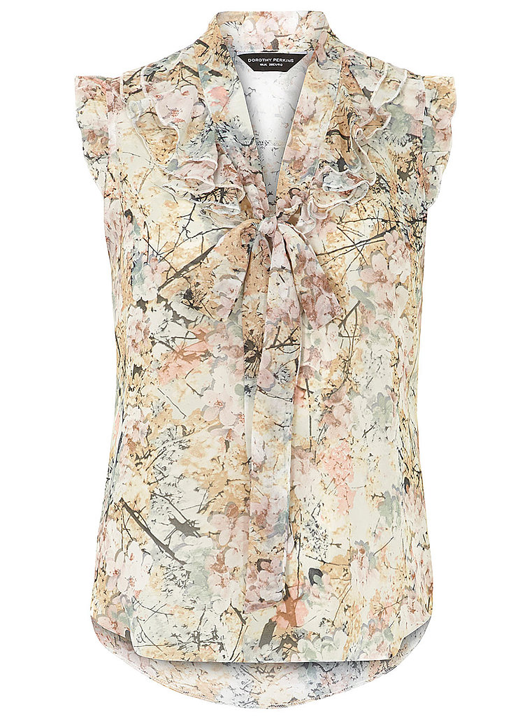 Muted instead of electro-bright, this floral bow blouse ($39) is a perfect way to bring blooms into Fall.