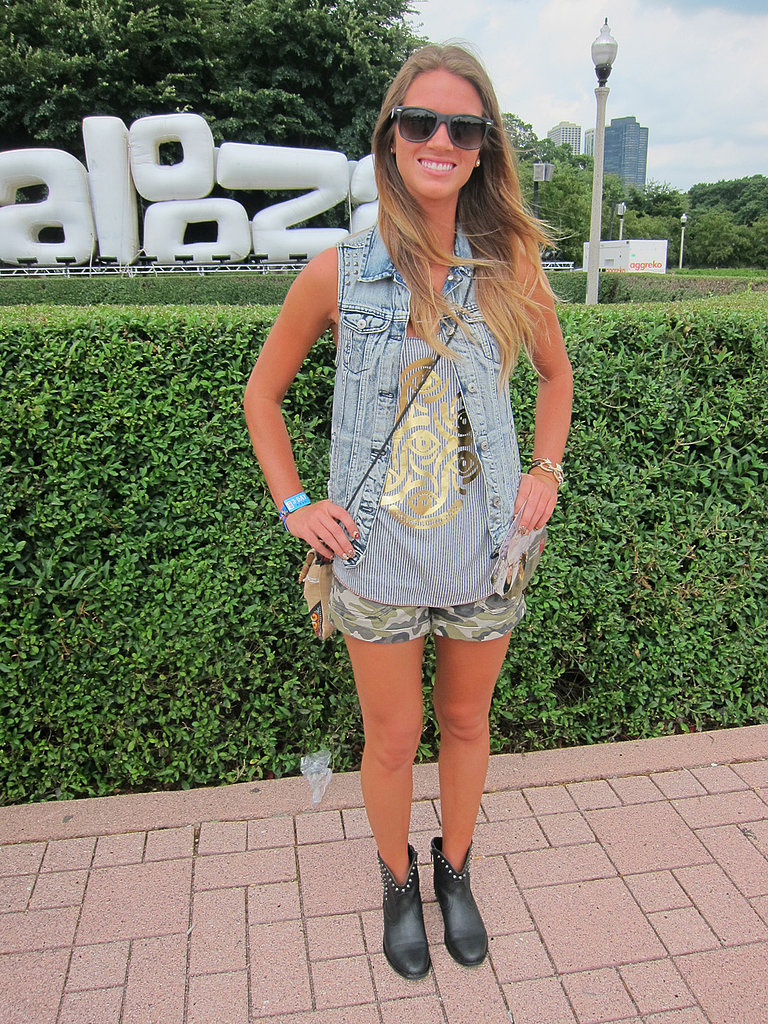 It doesn't get much cooler than Jessica's styling — from her washed denim vest to her evil-eye cotton tank to those cuffed camo shorts.