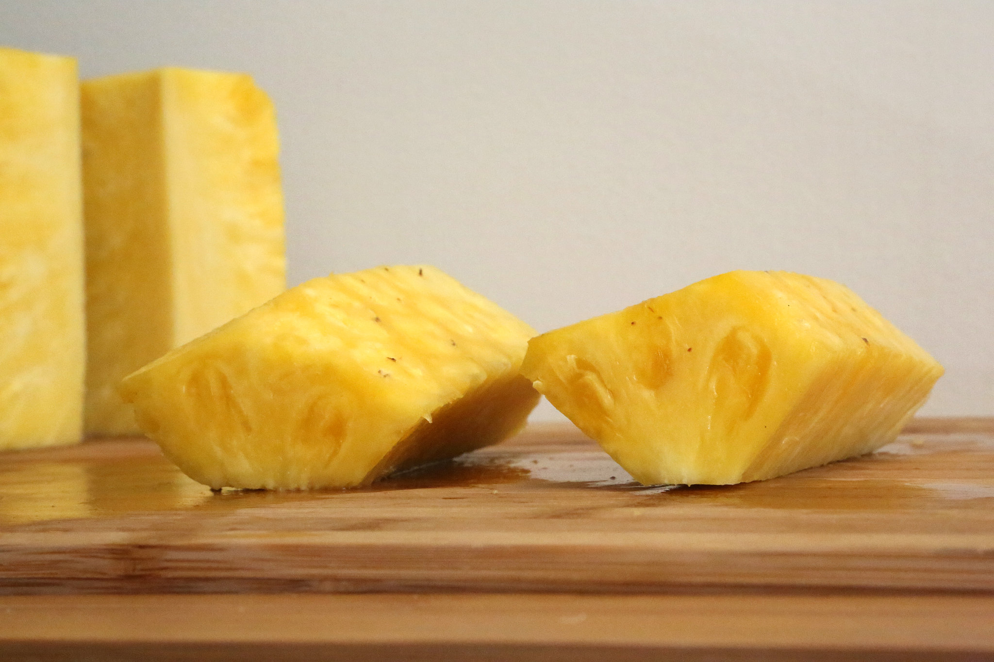 Now you have ready-to-cut pineapple spears.