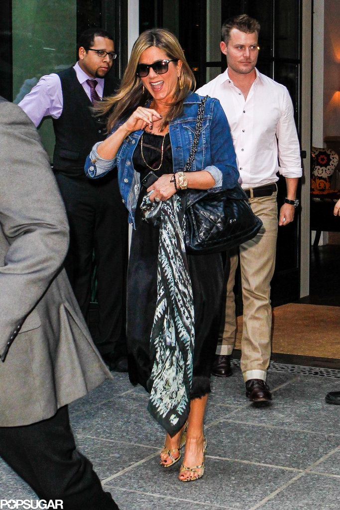 Jennifer Aniston gave a wave leaving her press day in NYC.