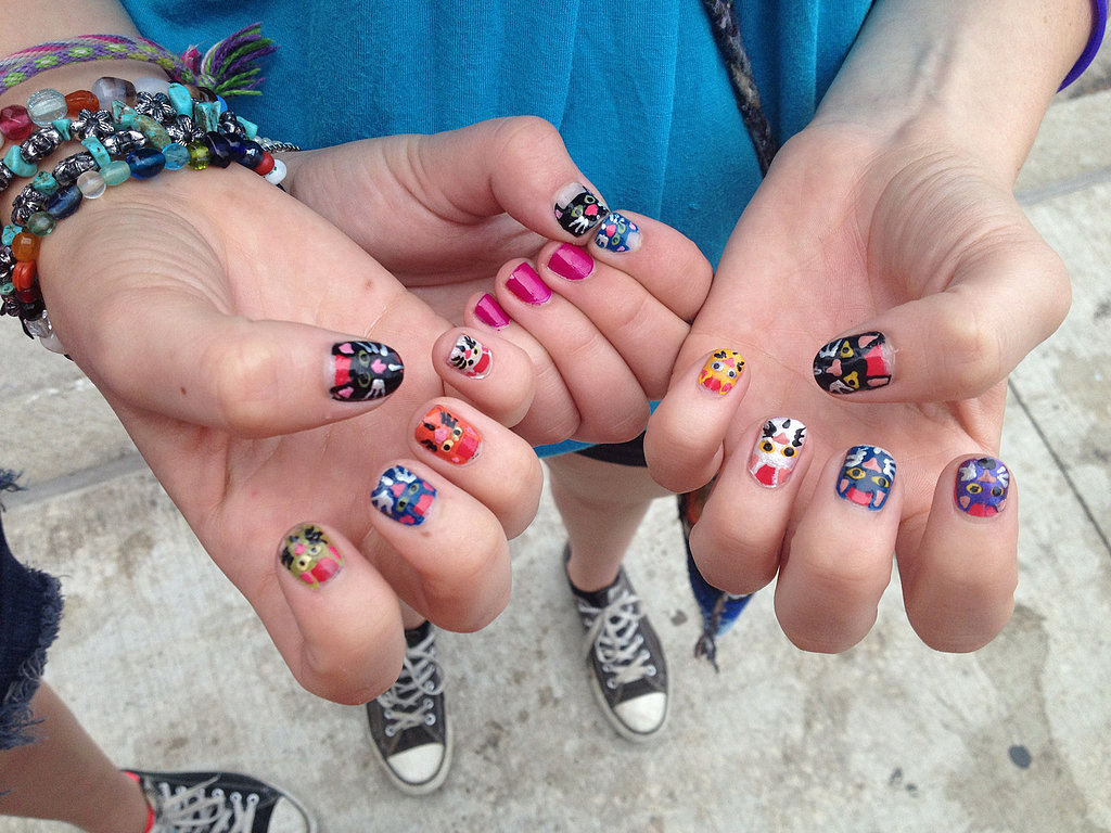 We'll give you one guess on this girl's favorite animal . . . or maybe she was planning to see Cat Power at the festival?