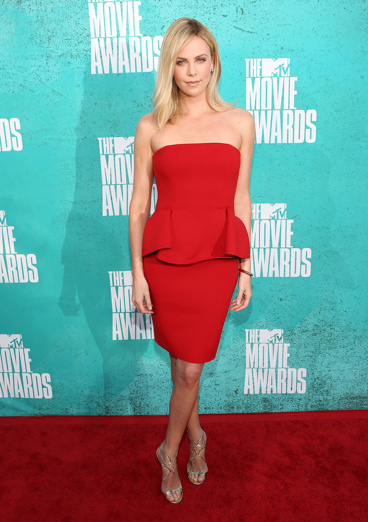 Charlize was red hot in a Lanvin peplum-trimmed strapless for the MTV 2012 Movie Awards.