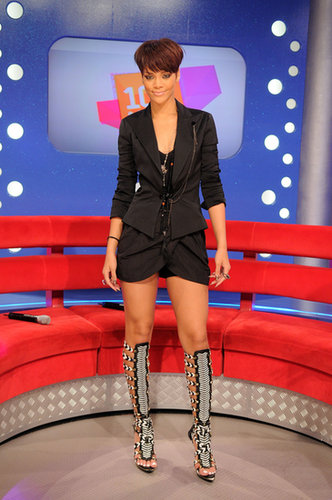 For a 2008 BET studios visit, Rihanna let her Balenciaga gladiator sandals do all the talking, pairing her statement shoes with an all-black short suit.