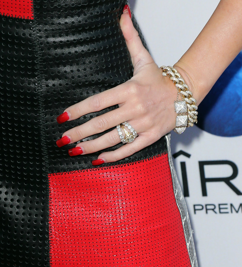 Miley Cyrus had a unique transparent manicure in a bright red color, and she was also rocking her gorgeous engagement ring.