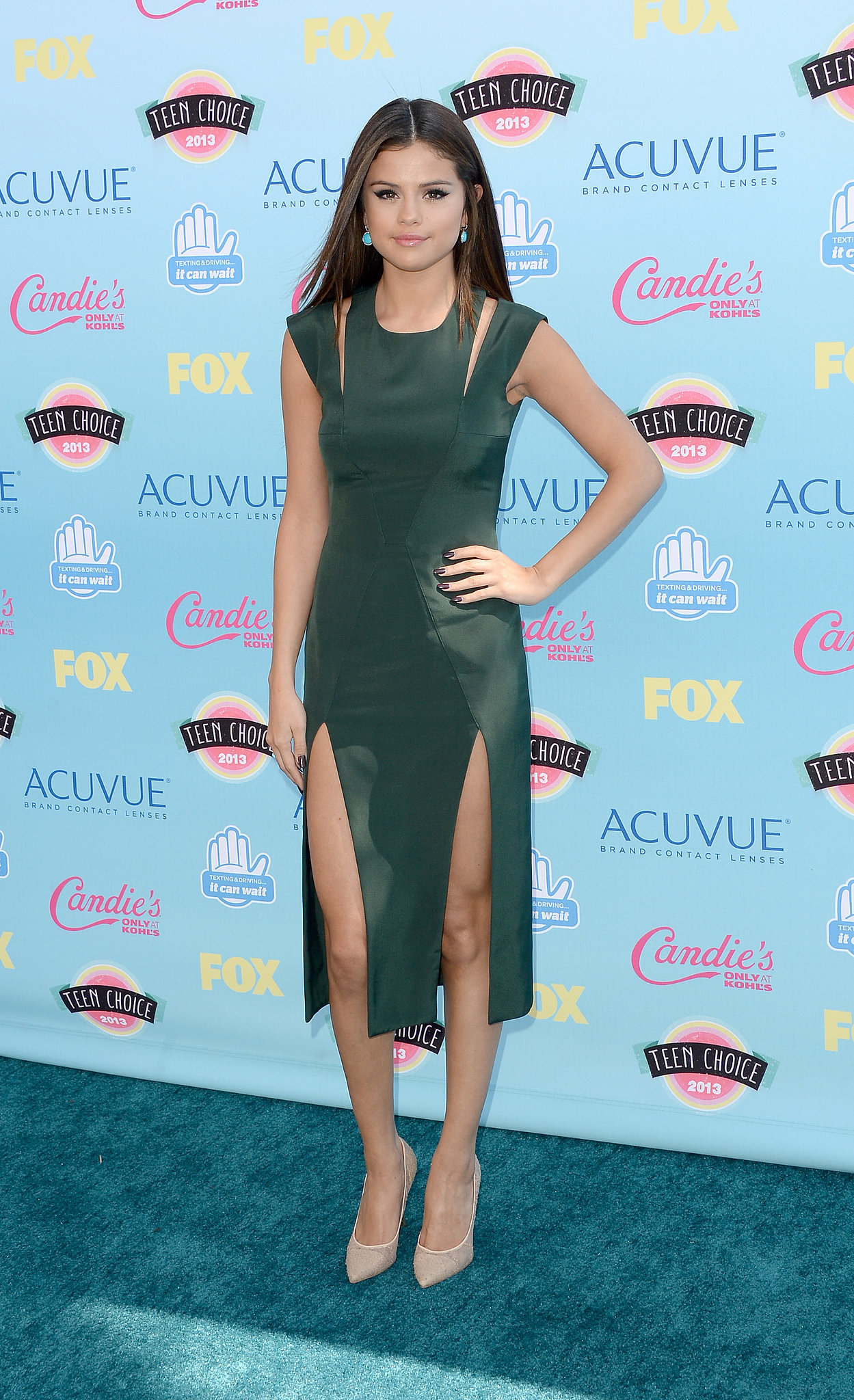 Selena Gomez was at her sexiest in a slitted green Cushnie et Ochs design, Nicholas Kirkwood pumps, and Neil Lane jewels.