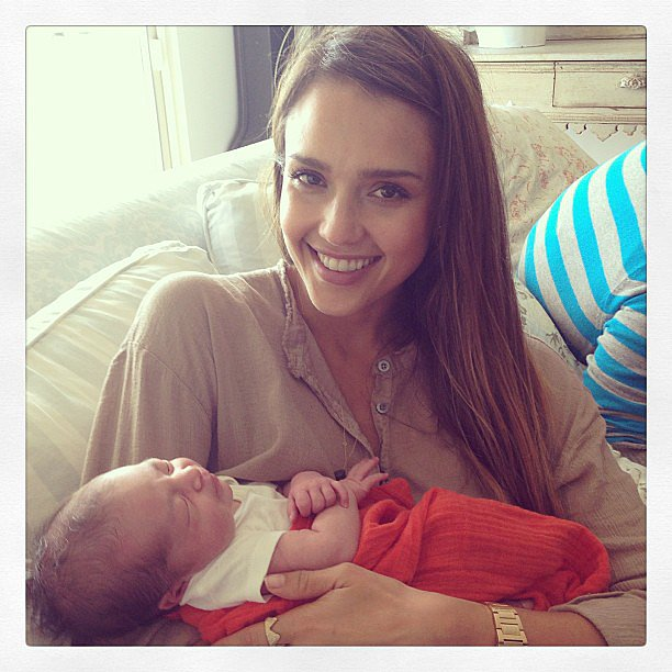 Jessica Alba cuddled with a friend's baby. Source: Instagram user jessicaalba