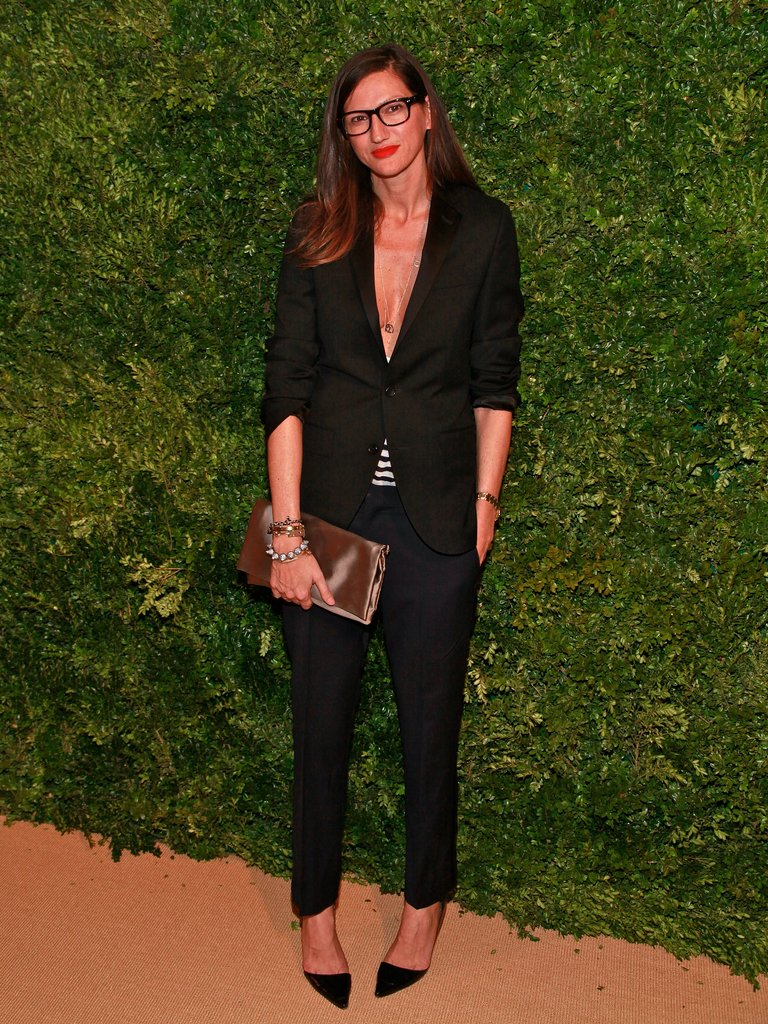 Another shot proves that she loves the look of a masculine suit made sexy with a deep V-neck top.