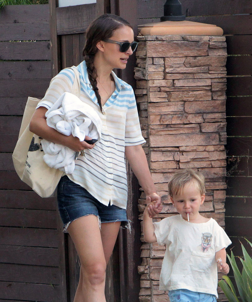 Natalie Portman's son, Aleph, enjoyed a lollipop while holding a backup in his hand.