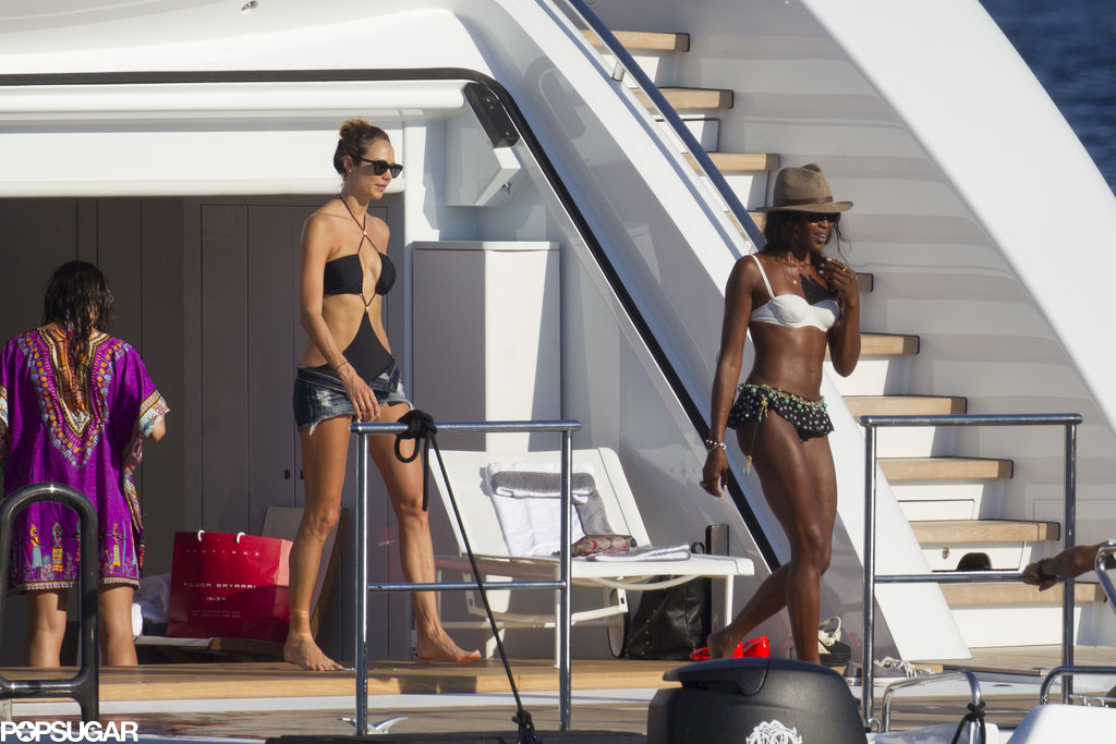 Bikini-clad Naomi Campbell hung out with Stacy Keibler on a yacht in Ibiza, Spain.