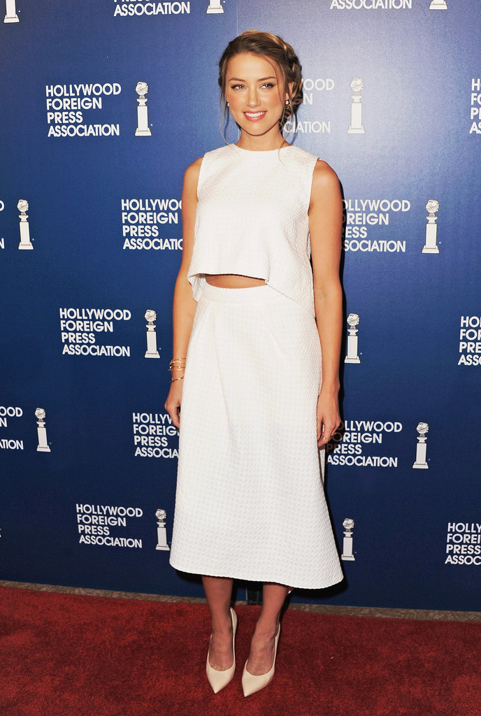 Embracing the last few weeks of Summer, Amber Heard picked a white crop top and skirt by Osman by Osman Yousefzada for the Hollywood Foreign Press Association's lunch.