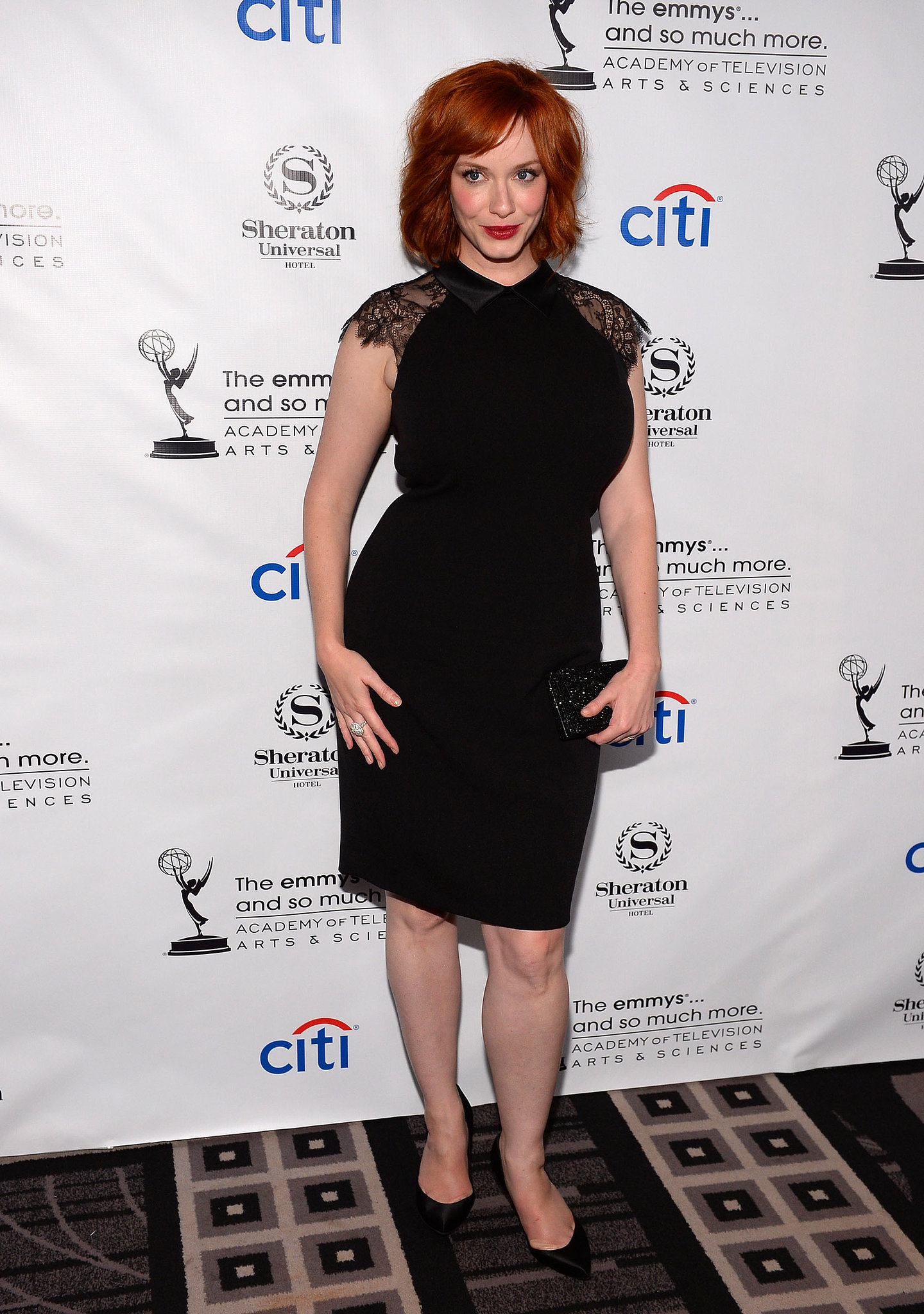 Christina Hendricks wore an LBD for the Emmys cocktail party.