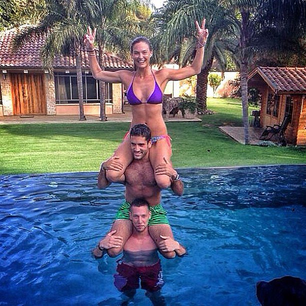 Bar Refaeli topped a three-person human totem pole while hitting the pool with friends. Source: Instagram user barrefaeli