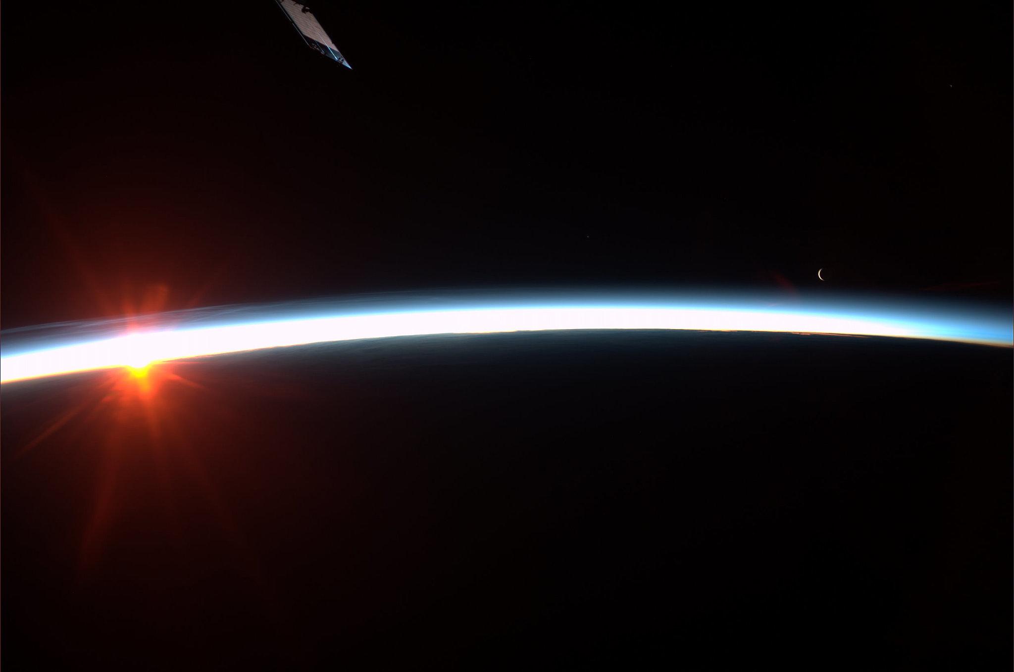 """Sunrise and moonrise. Taken August 4, 2013. KN from space."" Source: Pinterest user Karen Nyberg"