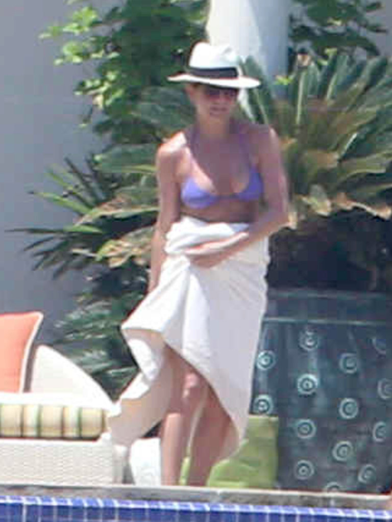 Jennifer Aniston wore a purple bikini.
