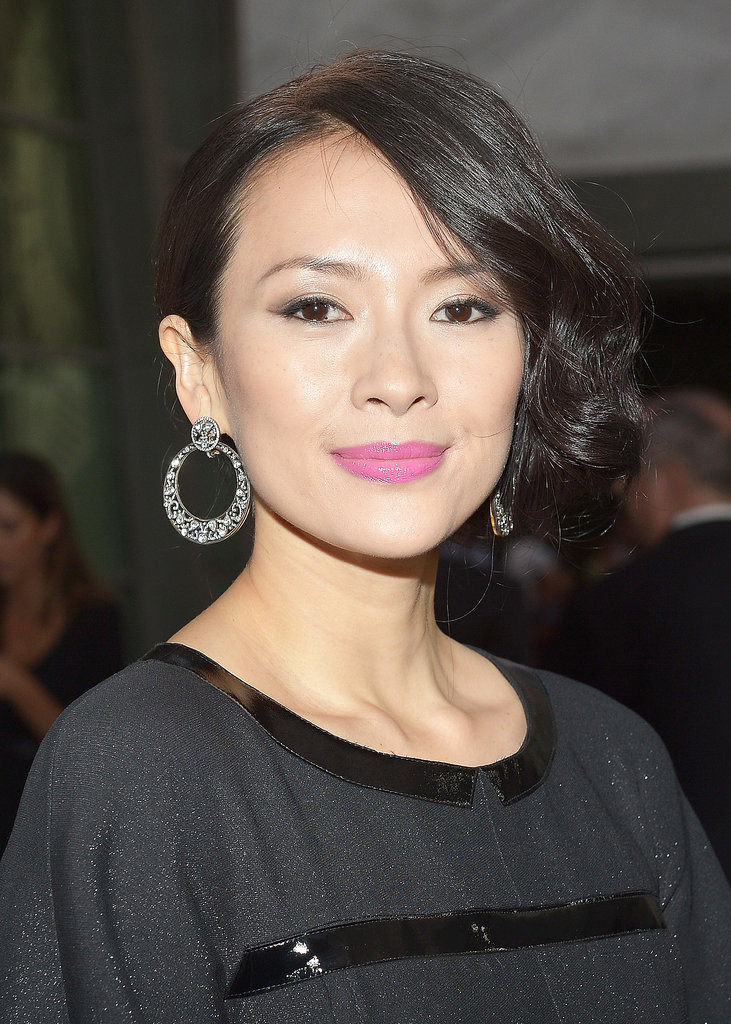 At The Grandmaster's premiere, Ziyi Zhang wore her hair in an asymmetrical chignon. For her makeup, she went with a pink lip accented with soft gray eye shadow.