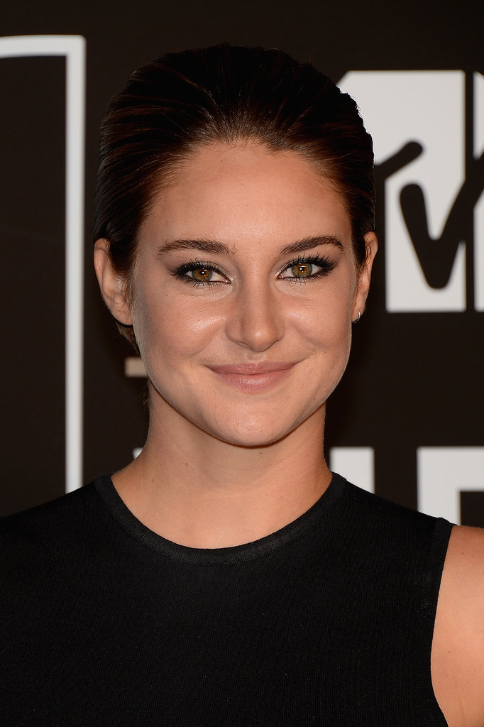 """When conceptualizing Shailene Woodley's MTV look, makeup artist Gloria Noto wanted the focus to be on the actress's eyes. """"I chose to create modern, smoky, elongated cat eyes with a wet, edgy, gunmetal look,"""" Noto explained. To get the high-gloss effect, Noto used the two darker metallic shades from the Pixi Shade Quartette in Shades of Taupe ($22) on Shailene's lids and rimmed the eyes with Pixi Lid Last Shadow Pen in Graphite Glint ($18)."""