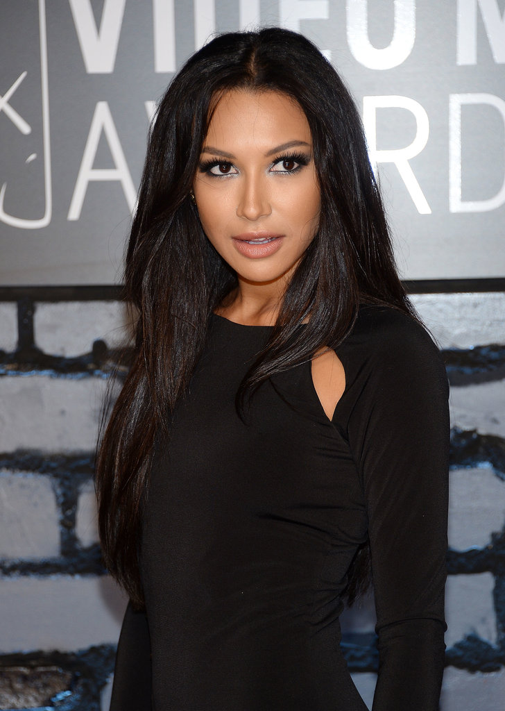 """Makeup artist Jo Baker was inspired by the '70s disco era when creating Naya Rivera's VMAs beauty look. To achieve this feel, Baker used the NP Set Day to Night Palette ($24) over Naya's lids. She then went over the top with NP Set All That Glitters Gel Duo in Sao Paulo ($10) for depth and shimmer. Black liner and mascara brought it all together.  For the hair, stylist Clyde Haygood created a """"modern-day Cher look"""" using Wella Professionals Velvet Amplifier (inquire for price) on damp hair prior to blow-drying, followed by the brand's Ocean Spritz (inquire for price) for added texture once dry."""